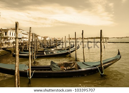 Venice. Sea. At the coast there are moored gondolas. Imitation of antiques