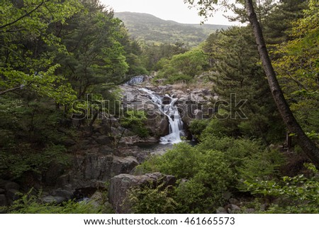 Verdant forest and small waterfalls at the Jangsan Mountain in Busan, South Korea.