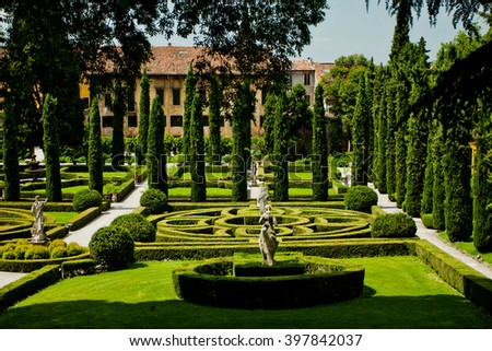 VERONA, ITALY - 15 JUNE: Amazing green Giusti garden with antique sculptures on june 15, 2013 in Verona, Italy.