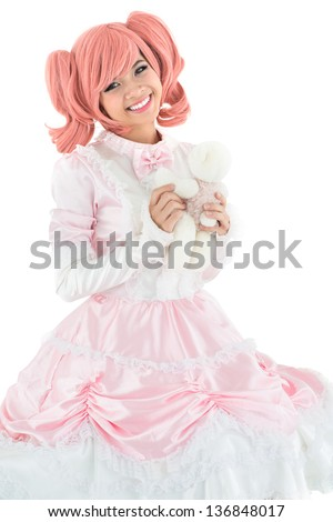 Vertical portrait of a pretty girl dressed like an anime princess