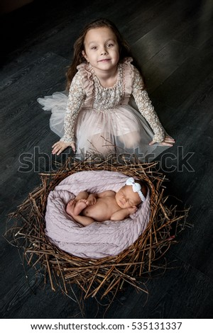 very cute newborn baby and toddler girl