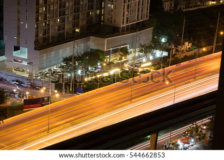 Vibrant city scape and great place for night life in this time exposure traffic shot of the highway and buildings in a concept showing vibrancy and electricity.
