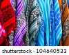 Vibrant handmade ponchos sold in the market. - stock photo