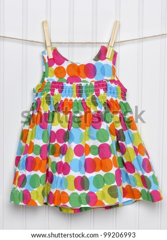 Vibrant Summemrtime Baby Girl Dress on a Clothesline.