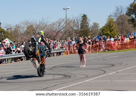 VICTORIA/AUSTRALIA - SEPTEMBER 2015: Stunt motorcycle rider performing at a local car show on the 13 September 2015 in Corowa.