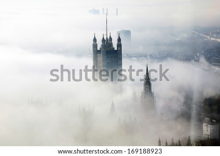 Victoria Tower of Palace of Westminster in fog seen from London Eye