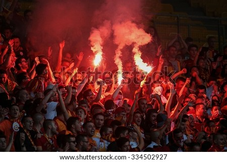 VIENNA, AUSTRIA - JULY 27, 2014: Fans of Galatasaray Istanbul cheer on their team during a friendly game against SK Rapid Vienna.