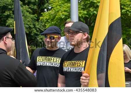 Vienna, Austria - June 11, 2016: Demonstrators with flags at demonstration of the Austrian Identitarian Movement in Vienna.