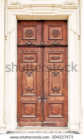 VIENNA, AUSTRIA - MAY 4: The Wooden door of St. Charles's Church on May 4, 2014 in Vienna. Karlskirche is dedicated to St. Charles Borromeo, one of the great reformers of the 16th century.