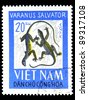 "VIETNAM - CIRCA 1966: A stamp printed in Vietnam shows Water monitor with the inscription ""Varanus salvator"" from the series ""Reptiles"", circa 1966 - stock photo"