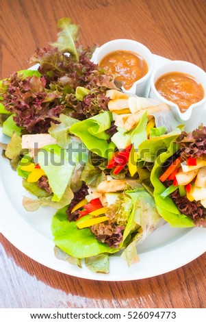 Vietnamese Meatball Wraps OR Nam Neung in white plate with sweet sauce - Healthy food style