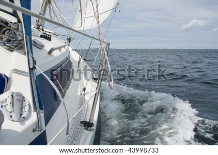 View from a sailing yacht, sailing in a good wind on lake Grevelingen