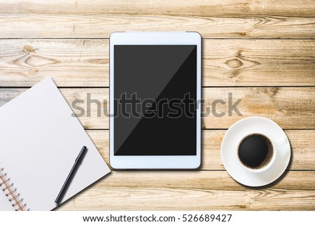 View from above with copy space  office table , Digital tablet with cup of coffee and notebook