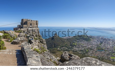 View from the flat top of Cape Town's Table Mountain. Views of Cape Town city, Atlantic ocean, harbor and Lion's Head hiking peak can be seen from the various cliff orientated mountain outlooks.