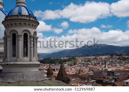 View from the roof of the New Cathedral over the red roofed colonial city of Cuenca, Ecuador