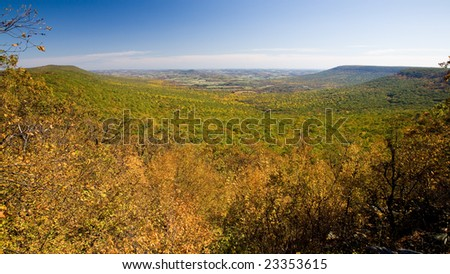 View from the top of Hawk Mountain, Pennsylvania, USA. Colorful fall foliage,  farmlands in the distance.