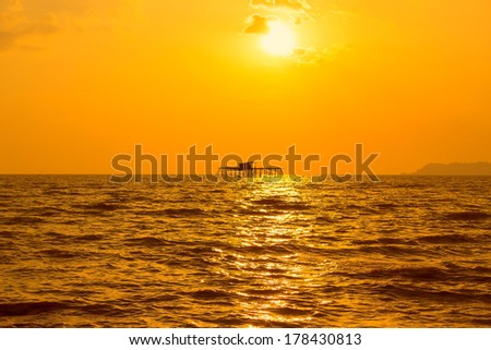 view kelong in the sea at sunset