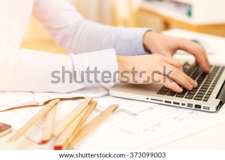 View of a Close up view of an architect working at office