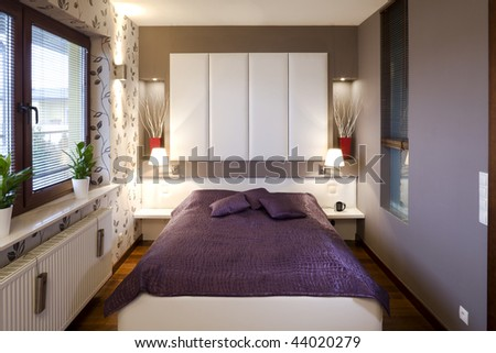 View of a comfortable, modern bedroom