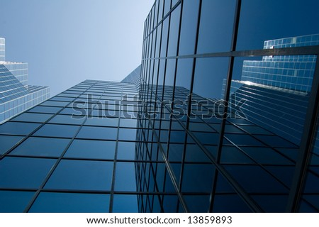 View of a modern downtown office building with reflective window
