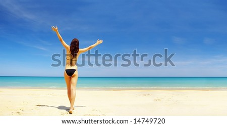 view of a nice  young female in tropical environment. Banner  lots of copy space.