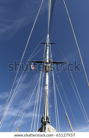 View of a sailing rig from the deck looking above at the mast