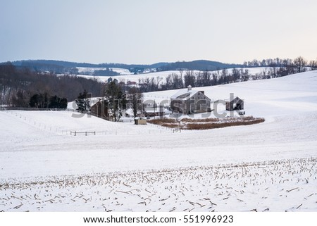 View of a snow covered farm and rolling hills, near Shrewsbury, Pennsylvania.