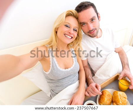 View of a Young attractive couple taking selfie during breakfast