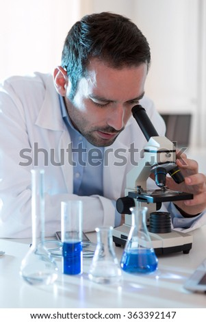 View of a Young attractive man working in a laboratory