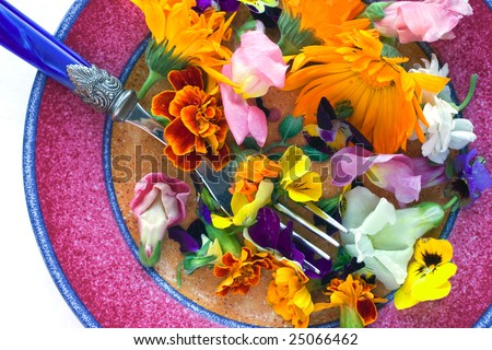 View of an assortment of edible flowers with plate and fork.