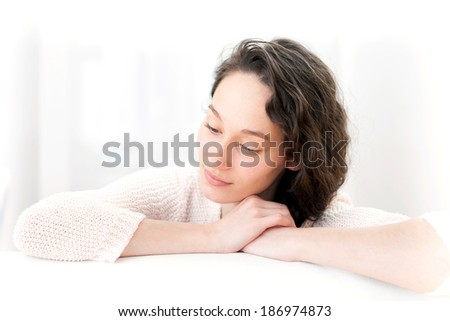View of an attractive thinking girl with curly hair