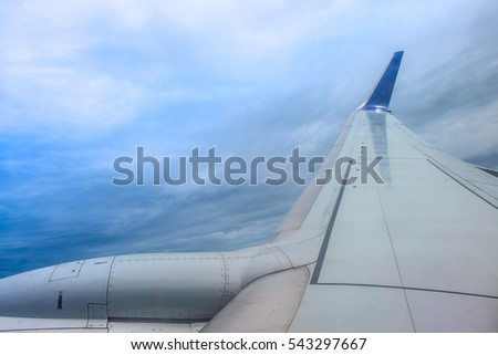 View of beautiful sky and cloud with wing of airplane from window