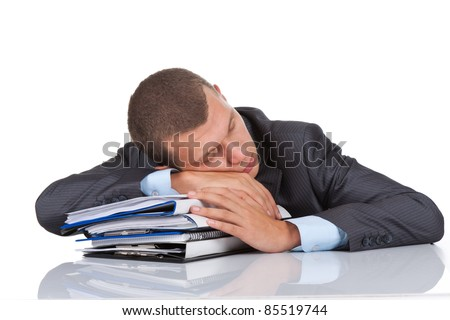 View of businessman sleep resting on stack of paperwork