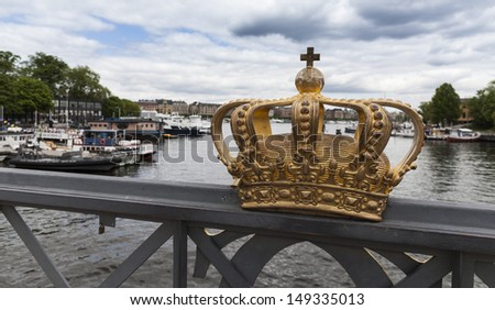 View of canal and bridge with royal crown in Stockholm