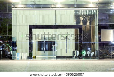 View of entrance modern building at night.