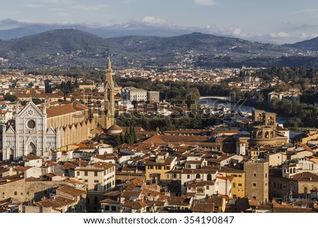 View of Florence - Basilica of Santa Croce in the foreground, the river Arno and the wooded mountains on the horizon