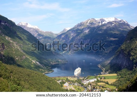 view of Geiranger fjord in Norway and a cruise ship