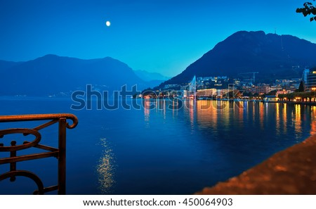 View of Lake Lugano with fountain in Lavena Ponte Tresa, Switzerland night