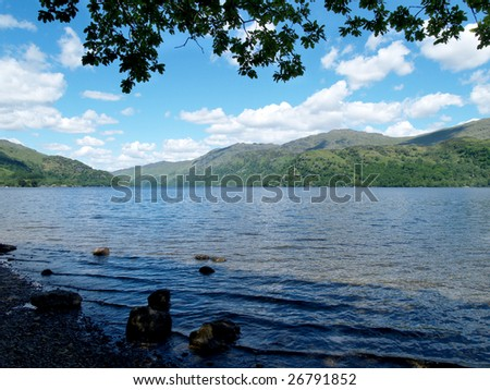 View of Loch Lomond from shoreline under trees