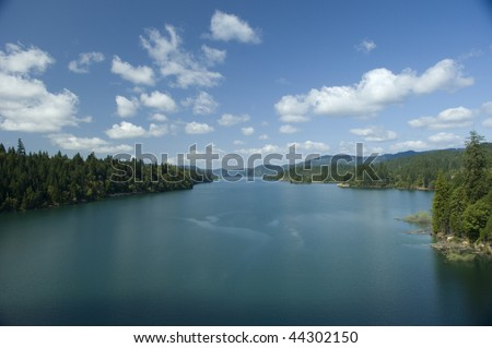 View of Lost Creak Lake in mid summer with blue sky and clouds
