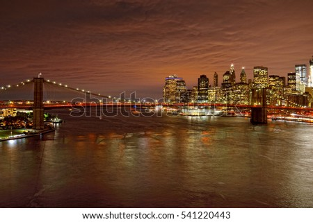View of Lower Manhattan with Brooklyn Bridge at night.
