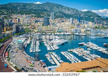 View of luxury yachts and apartments in harbor of Monaco, Cote d'Azur.