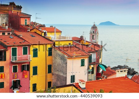 View of many cozy colorful houses in Tellaro village, Ligurian province, Italy. Beautiful Italian architecture.