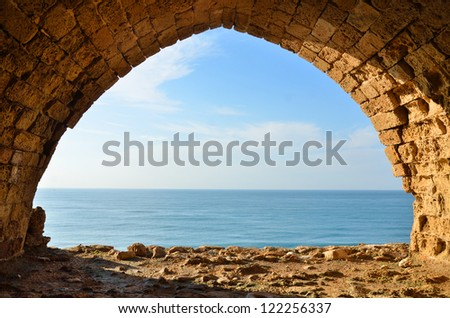 view of Mediterranean sea from window in Crusaders fortress in Israel