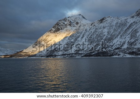 View of mountain Stauren at sunset in Gryllefjord on Senja Island, Troms county, Norway