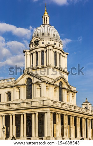 View of Old Royal Naval College building (UNESCO World Heritage Site) at sunset. Greenwich, London, UK