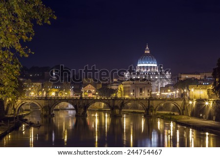 view of Ponte Vittorio Emanuele II and St. Peter's Basilica in evening, Rome