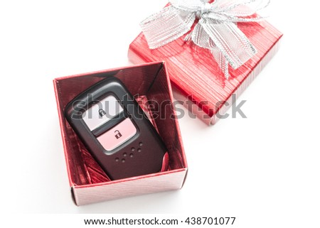 View of remote car keys in a box