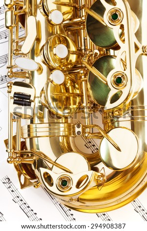 View of shiny alto saxophone bow part with keys