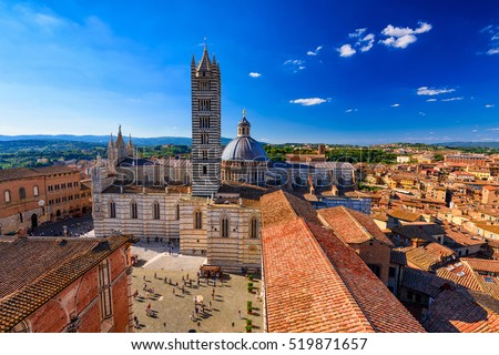 View of Siena Cathedral (Duomo di Siena) and Piazza del Duomo in Siena, Italy. Siena is capital of province of Siena. Historic centre of Siena has been declared by UNESCO a World Heritage Site